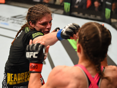 FAIRFAX, VA - APRIL 04:   (L-R) Lauren Murphy punches Liz Carmouche in their women's bantamweight fight during the UFC Fight Night event at the Patriot Center on April 4, 2015 in Fairfax, Virginia. (Photo by Josh Hedges/Zuffa LLC/Zuffa LLC via Getty Image