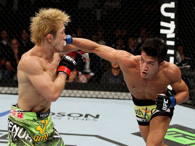 SAITAMA, JAPAN - SEPTEMBER 20: Kyung Ho Kang throws  a punch on Michinori Tanaka in their bantamweight bout during the UFC Fight Night event inside the Saitama Arena on September 20, 2014 in Saitama, Japan. (Photo by Mitch Viquez/Zuffa LLC/Zuffa LLC via G