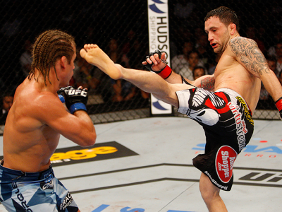 MANILA, PHILIPPINES - MAY 16: Frankie Edgar of the United States throws a kick at Uriah Faber of the United States in their featherweight fight during the UFC Fight Night event at the Mall of Asia Arena on May 16, 2015 in Manila, Philippines. (Photo by Mi