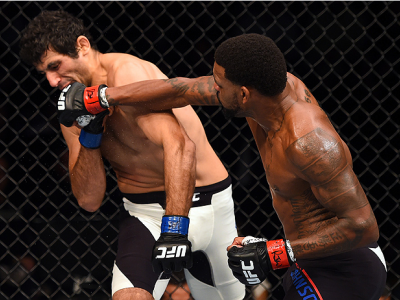 NASHVILLE, TN - AUGUST 08:  (R-L) Michael Johnson punches Beneil Dariush in their lightweight bout during the UFC Fight Night event at Bridgestone Arena on August 8, 2015 in Nashville, Tennessee.  (Photo by Josh Hedges/Zuffa LLC/Zuffa LLC via Getty Images