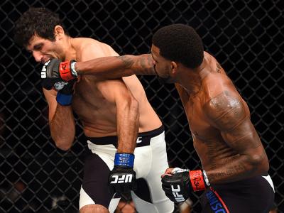 NASHVILLE, TN - AUGUST 08:  (R-L) Michael Johnson punches Beneil Dariush in their lightweight bout during the UFC Fight Night event at Bridgestone Arena on August 8, 2015 in Nashville, Tennessee.  (Photo by Josh Hedges/Zuffa LLC/Zuffa LLC via Getty Images