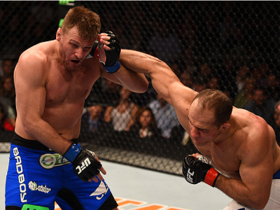 PHOENIX, AZ - DECEMBER 13:  (R-L) Junior Dos Santos of Brazil punches Stipe Miocic in their heavyweight fight during the UFC Fight Night event at the U.S. Airways Center on December 13, 2014 in Phoenix, Arizona.  (Photo by Josh Hedges/Zuffa LLC/Zuffa LLC