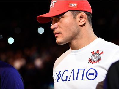 PHOENIX, AZ - DECEMBER 13:  Junior Dos Santos of Brazil enters the arena before facing Stipe Miocic in their heavyweight fight during the UFC Fight Night event at the U.S. Airways Center on December 13, 2014 in Phoenix, Arizona.  (Photo by Josh Hedges/Zuf