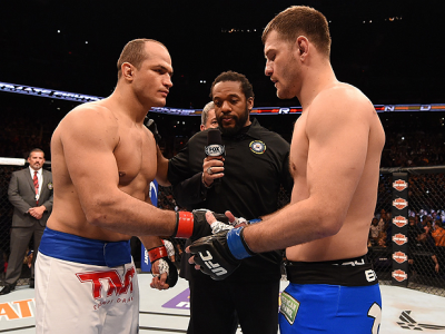PHOENIX, AZ - DECEMBER 13:  (L-R) Junior Dos Santos of Brazil and Stipe Miocic touch gloves before their heavyweight fight during the UFC Fight Night event at the U.S. Airways Center on December 13, 2014 in Phoenix, Arizona.  (Photo by Josh Hedges/Zuffa L