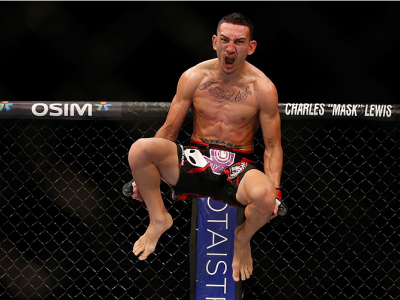 SINGAPORE - JANUARY 04:  Max Holloway reacts after his TKO victory over Will Chope in their featherweight bout during the UFC Fight Night event at the Marina Bay Sands Resort on January 4, 2014 in Singapore. (Photo by Josh Hedges/Zuffa LLC/Zuffa LLC via G