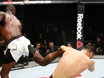 SAITAMA, JAPAN - SEPTEMBER 27: Uriah Hall of Jamaica lands a back kick to drop his opponent, Gegard Mousaasi of Iran in their middleweight bout during the UFC event at the Saitama Super Arena on September 27, 2015 in Saitama, Japan. (Photo by Mitch Viquez