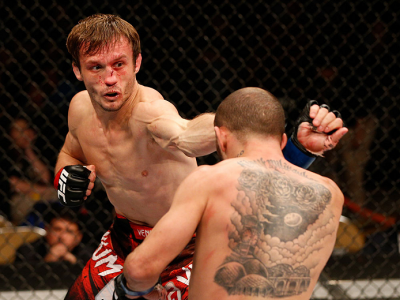 AUSTIN, TX - NOVEMBER 22:  (L-R) Brad Pickett of England punches Chico Camus in their flyweight bout during the UFC Fight Night event at The Frank Erwin Center on November 22, 2014 in Austin, Texas.  (Photo by Josh Hedges/Zuffa LLC/Zuffa LLC via Getty Ima