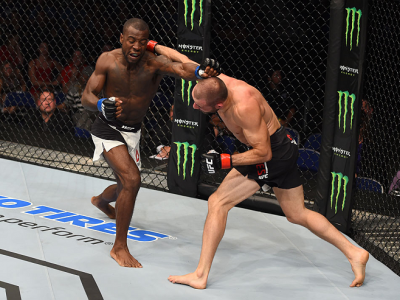 SASKATOON, SK - AUGUST 23:  (L-R) Chris Beal of the United States and Chris Kelades trade punches in their flyweight bout during the UFC event at the SaskTel Centre on August 23, 2015 in Saskatoon, Saskatchewan, Canada. (Photo by Jeff Bottari/Zuffa LLC/Zu