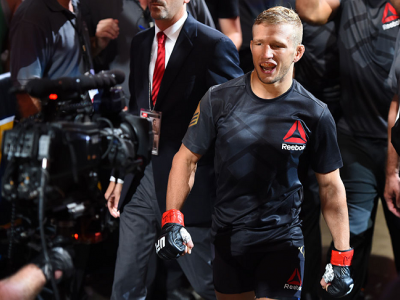 CHICAGO, IL - JULY 25:   TJ Dillashaw enters the arena before his UFC bantamweight championship bout against Renan Barao of Brazil during the UFC event at the United Center on July 25, 2015 in Chicago, Illinois. (Photo by Jeff Bottari/Zuffa LLC/Zuffa LLC