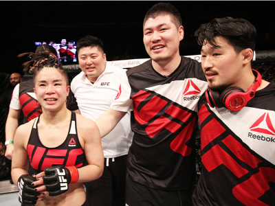 SEOUL, SOUTH KOREA - NOVEMBER 28: Seohee Ham of South Korea and her team after her victory over Cortney Casey of the United States of America in their  strawweight bout during the UFC Fight Night at the Olympic Park Gymnastics Arena on November 28, 2015 i