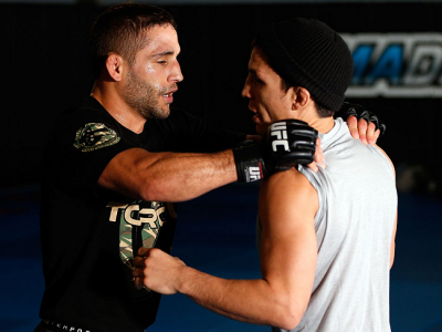SACRAMENTO, CA - DECEMBER 11:  (L-R) Teammates Chad Mendes and Joseph Benavidez workout together during an open training session for media at Ultimate Fitness on December 11, 2013 in Sacramento, California. (Photo by Josh Hedges/Zuffa LLC/Zuffa LLC via Ge